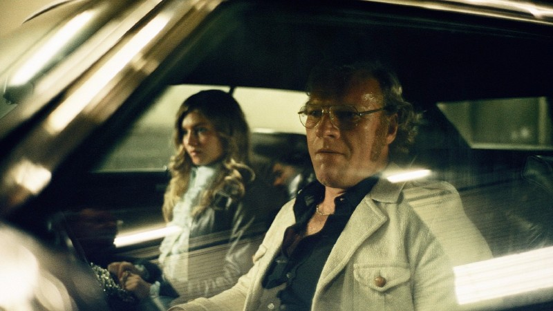 A movie screenshot of Call Girl: Iris in the car with a man