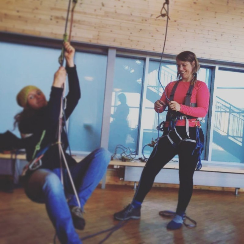 Arctic Nature Guide students practicing rope work indoors